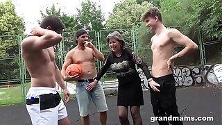 Horny Granny Fucks Basketball Twinks in Public