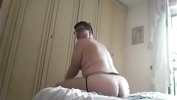 Smooth booty playing with a toy